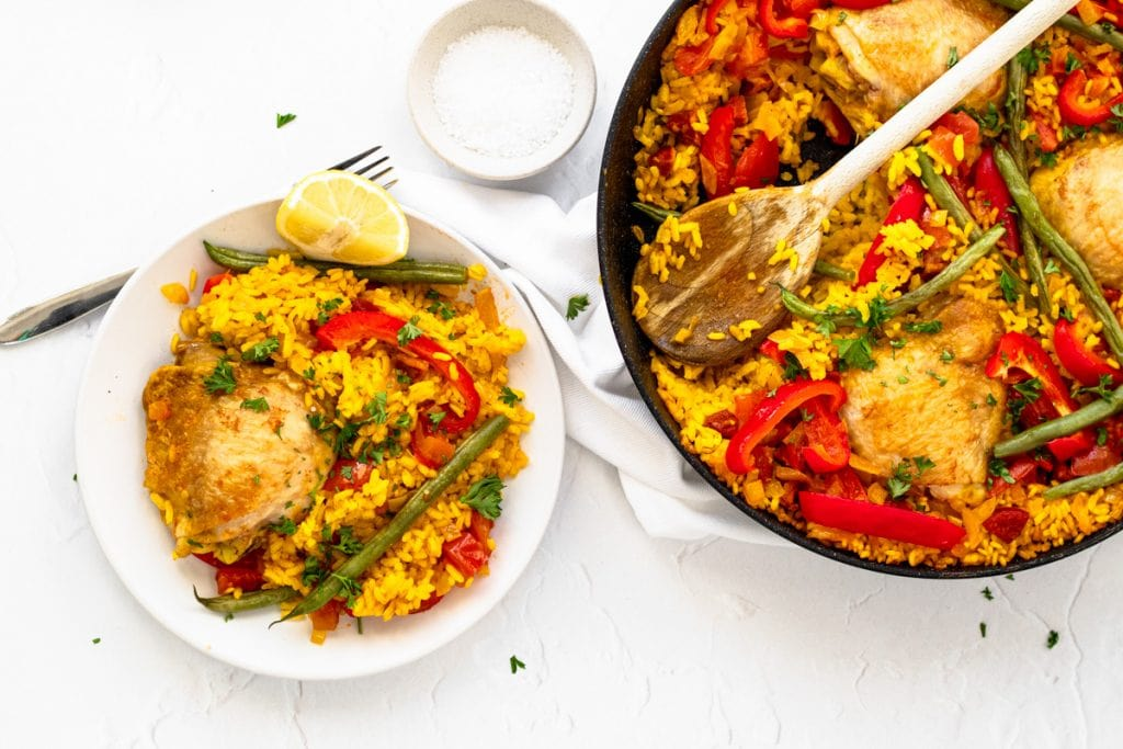 chicken and chorizo paella in pan and on plate