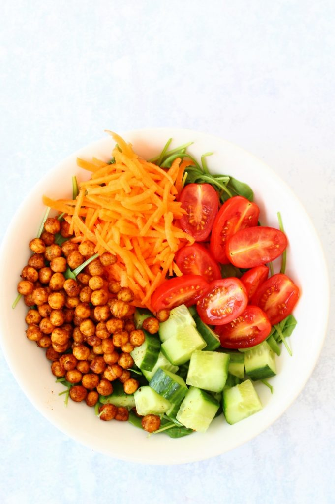 healthy roasted chickpea salad bowl with chickpeas, cucumber, carrot and tomatoes