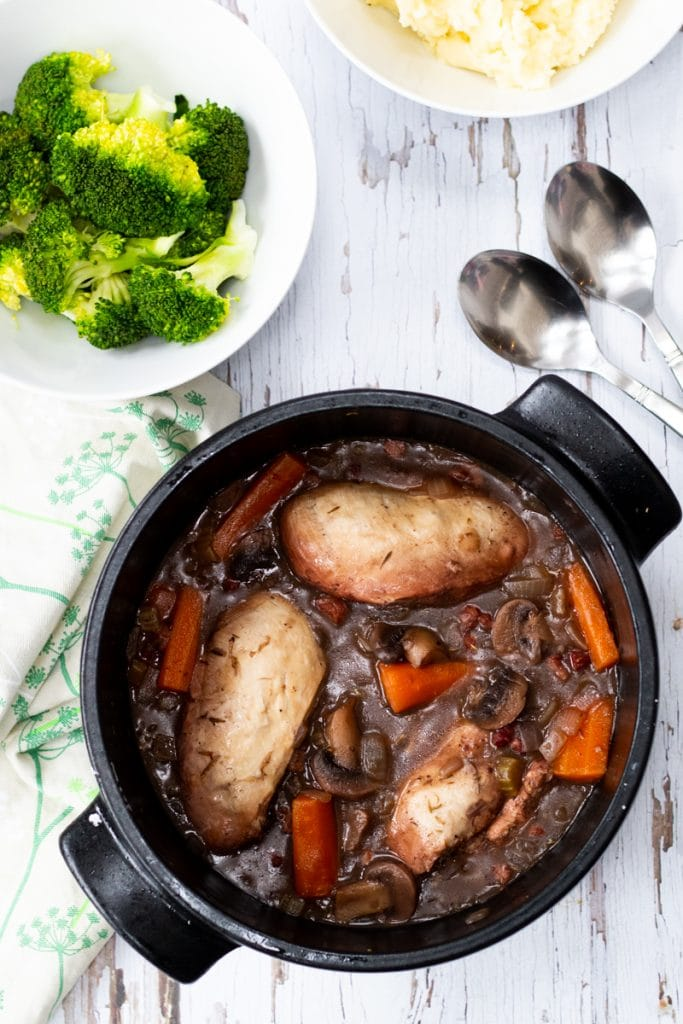 easy coq au vin in a saucepan with broccoli and mashed potato