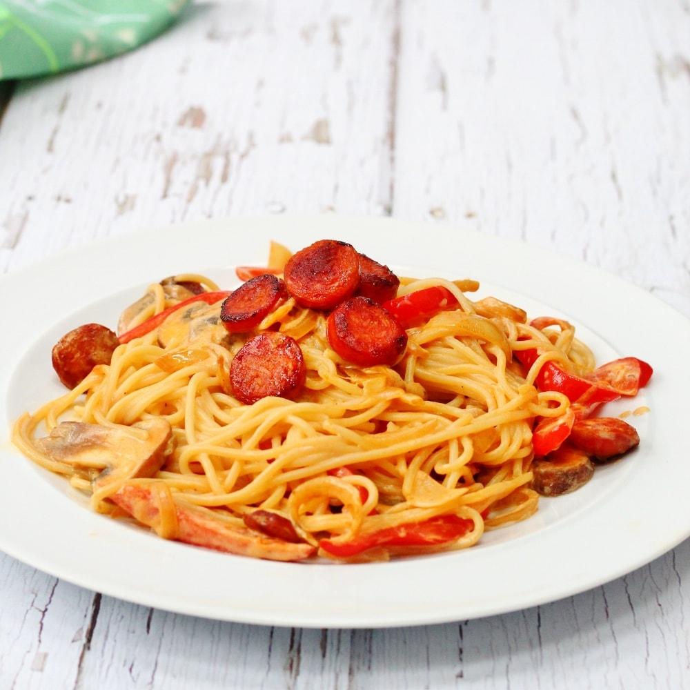 white plate with chorizo pasta;