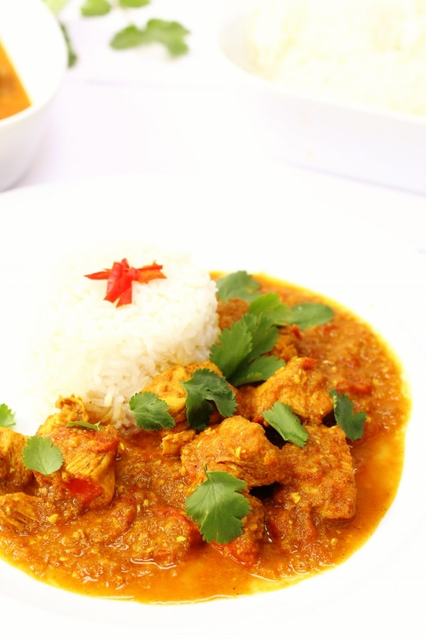 Burmese chicken curry on a plate with ricce