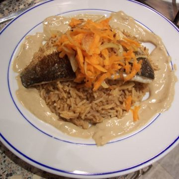 Sea bass with tahini sauce and saffron rice