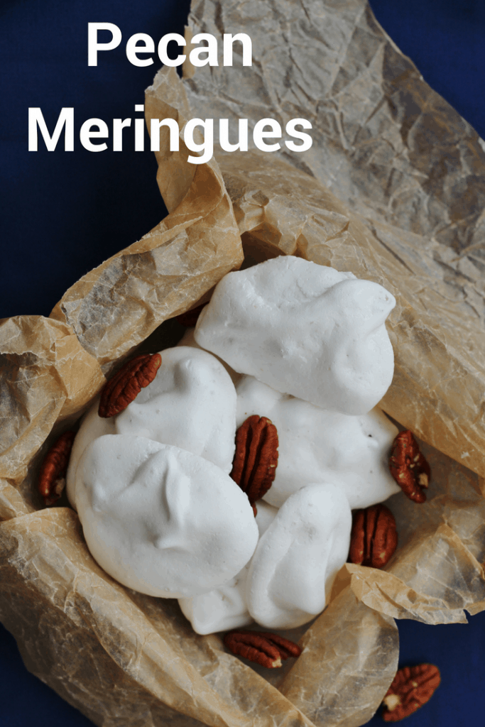 These pecan meringues are so versatile. Eat them like cookies as a snack or crush them up with cream and strawberries to make a summer dessert. The pecans make these little meringues lovely and nutty. The perfect snack or dessert. #pecanmeringues #pecans #meringues #snacks #sweet #dessert #ediblegifts #eggwhites #recipes #nuts