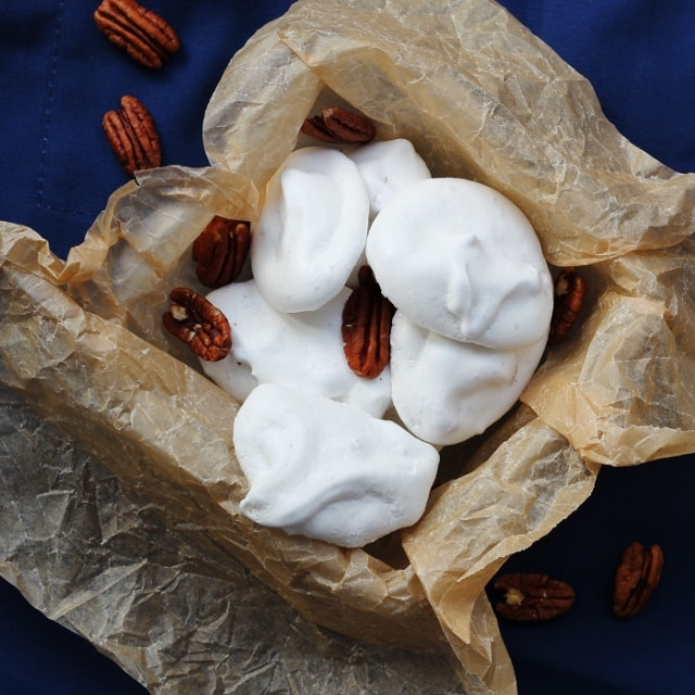 Pecan meringues on a blue background