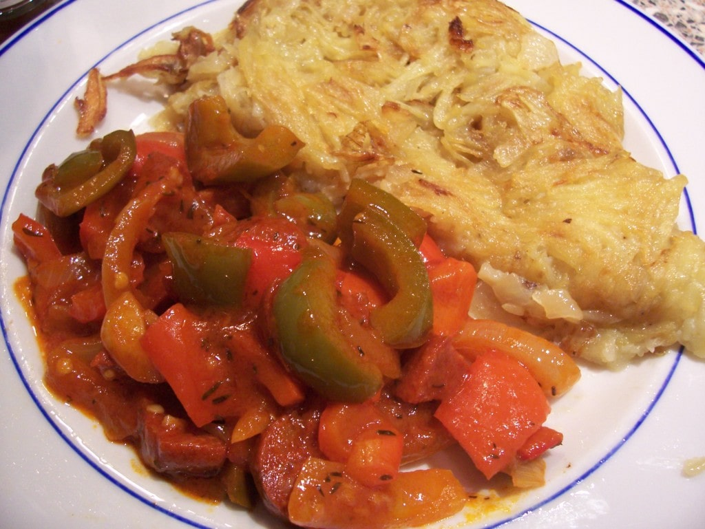 Potato rosti and red and green pepper ragout with chorizo
