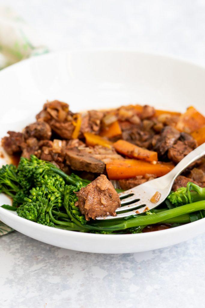 Slow cooker juniper beef stew in a bowl