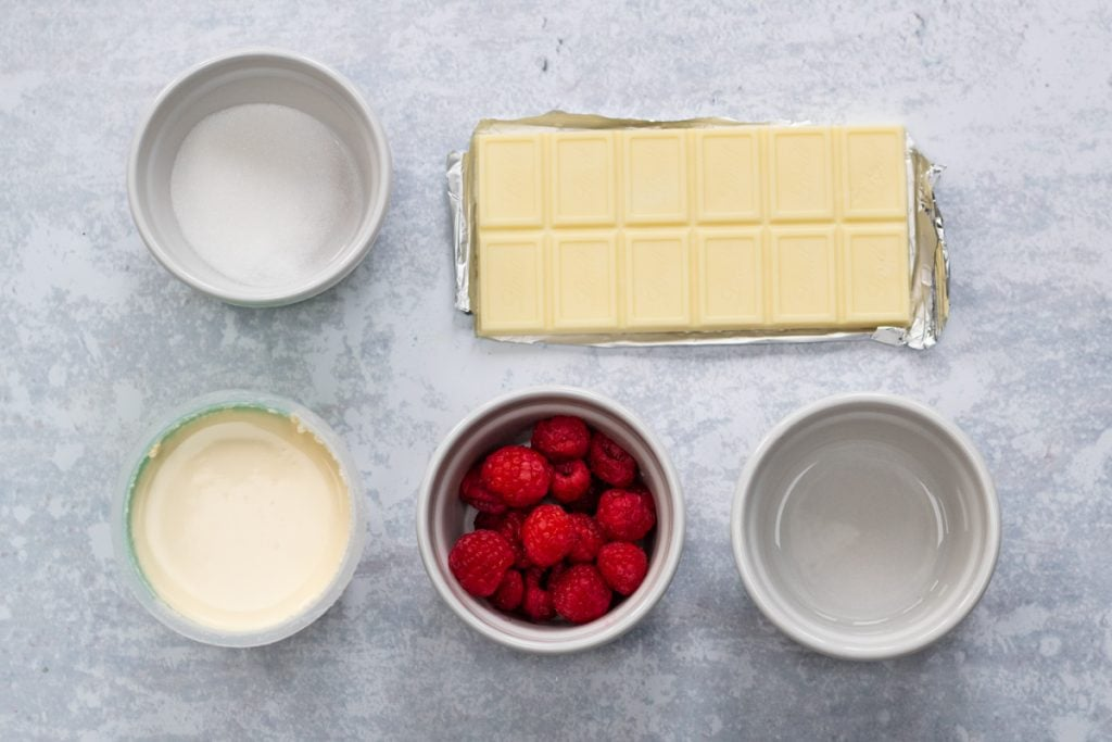 Ingredients for white chocolate mousse and raspberry sauce