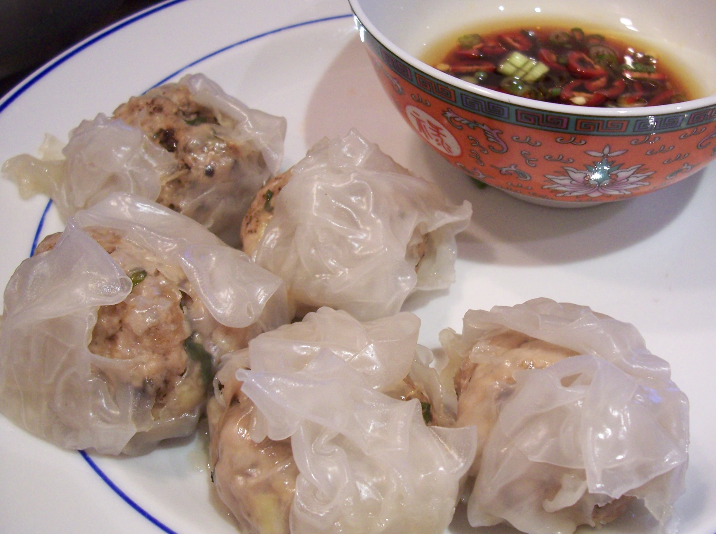 Steamed pork dumplings with a dipping sauce