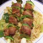 Asian duck kebabs on noodles