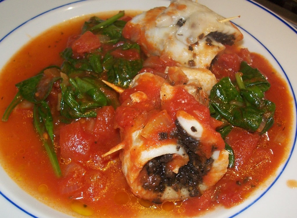 Fish with spinach olives and tomatoes