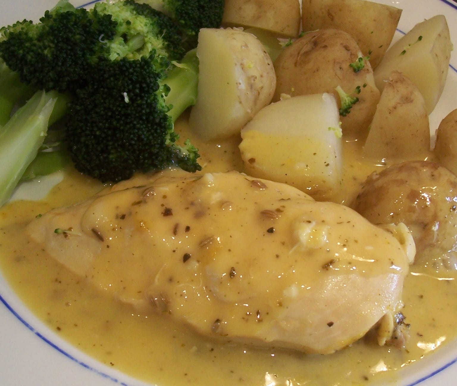 chicken breast in lemon sage sauce with potatoes and broccoli