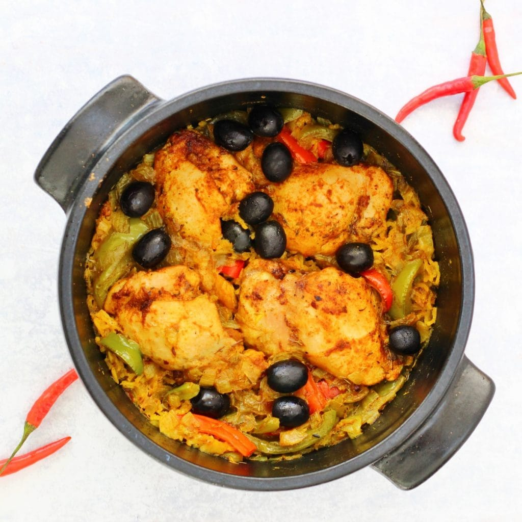 One pot meal of Puerto Rican chicken in the pan