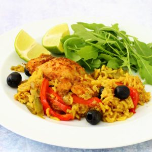 Puerto rican chicken: chicken, olives and peppers cooked in spicy rice on a plate