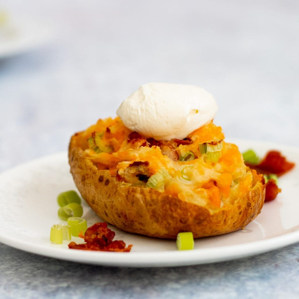 jacket potato skin stuffed with onions, bacon and cheese