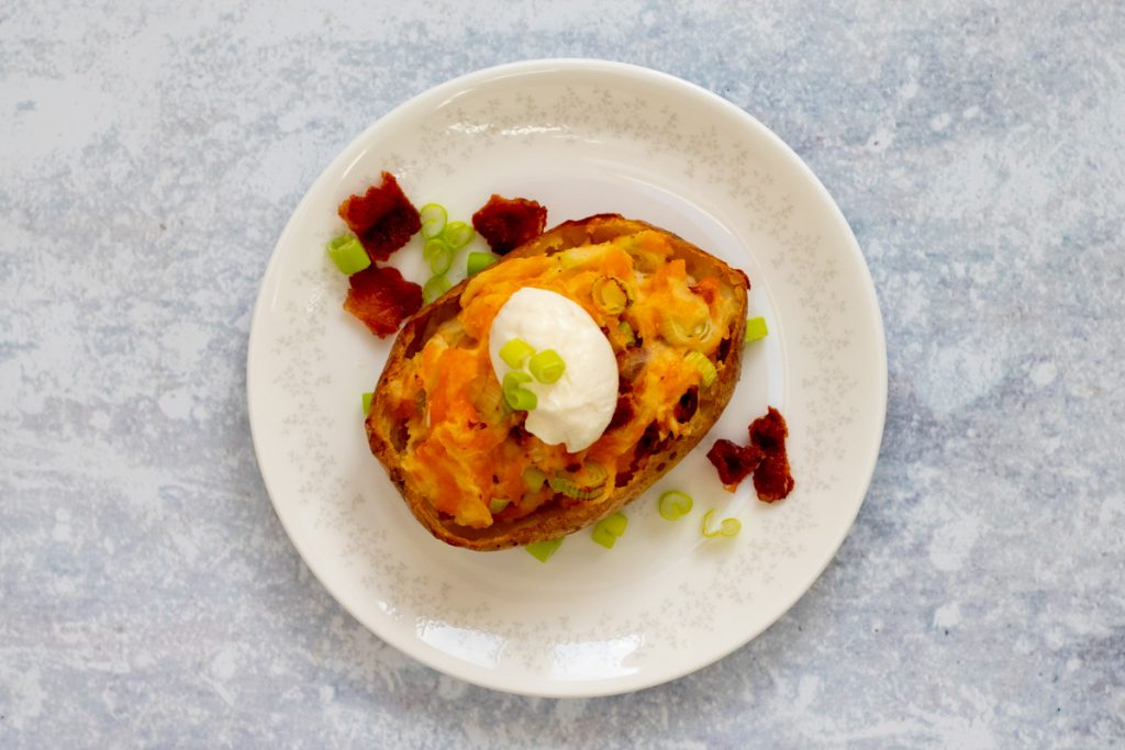 jacket potato stuffed with cheese, bacon and onion