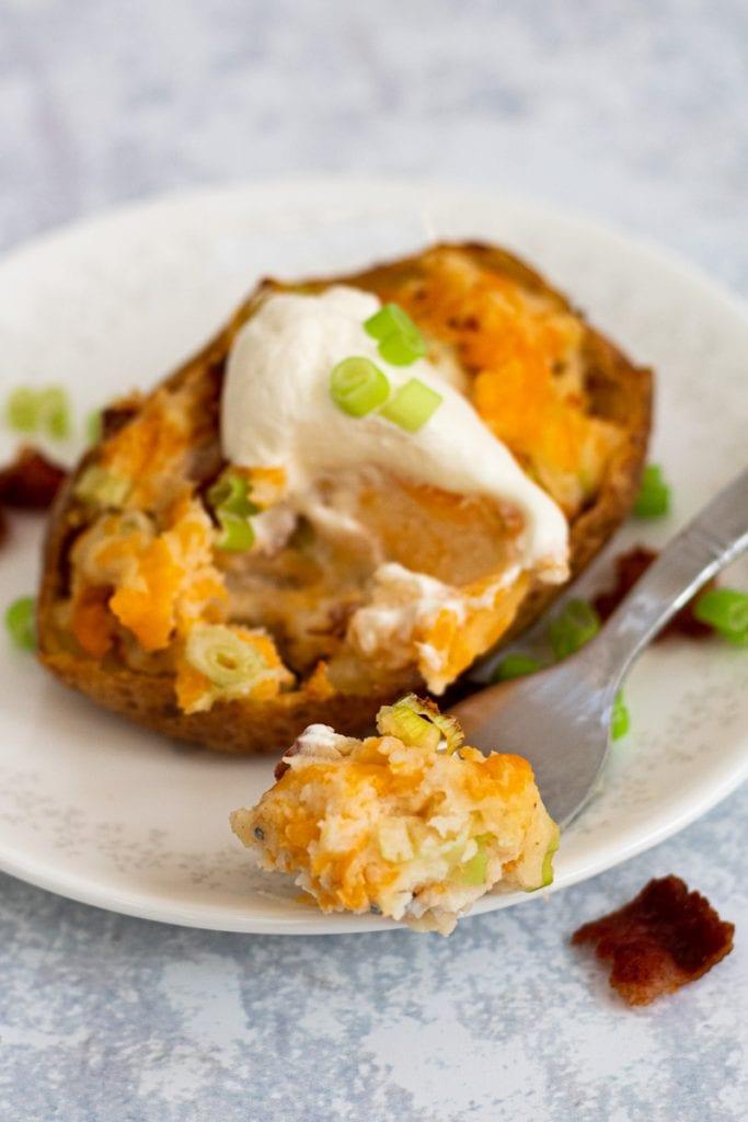 stuffed jacket potato with a fork with potato on