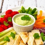 coriander, yogurt avocado dip with veggies and pitta bread