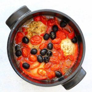 Cast Iron pot of baked Italian Chicken