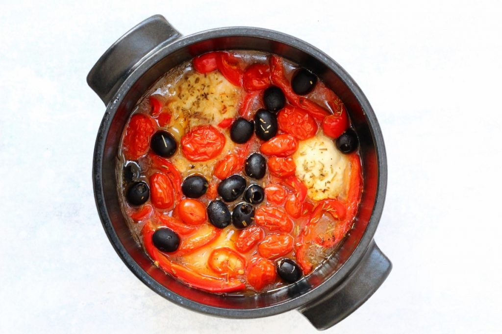 Pot of baked Italian chicken with olives, tomatoes, peppers