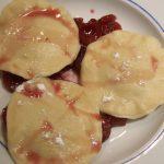 Chocolate ravioli with cherry sauce