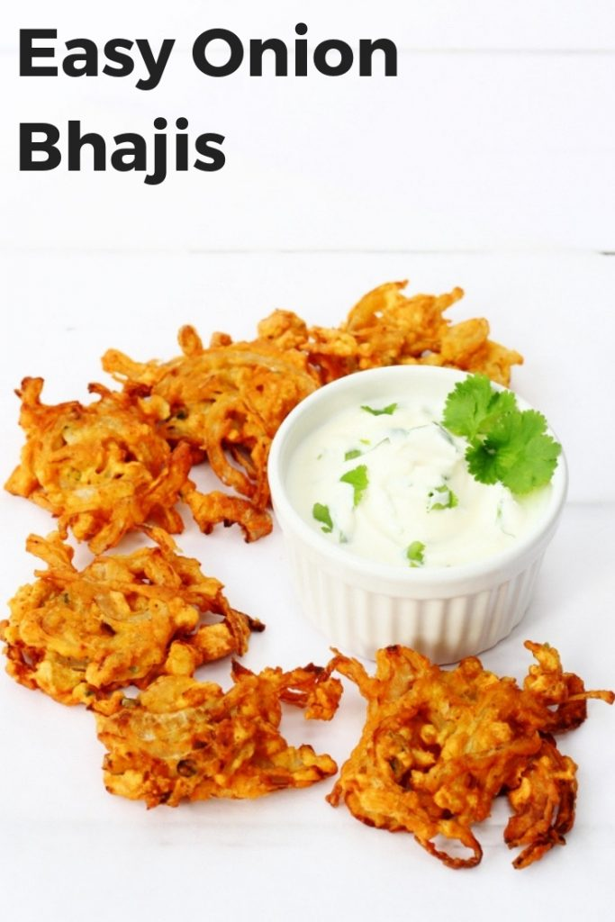 This easy onion bhajis recipe is the perfect side dish or appetizer for an Indian dinner at home.   Simple and quick to make and so crispy too.   Perfect with a squeeze of lemon! #onionbhajis #sidedish #indianrecipe #fromscratch #spicy #fakeaway