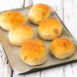 Easy homemade burger buns on a baking tray
