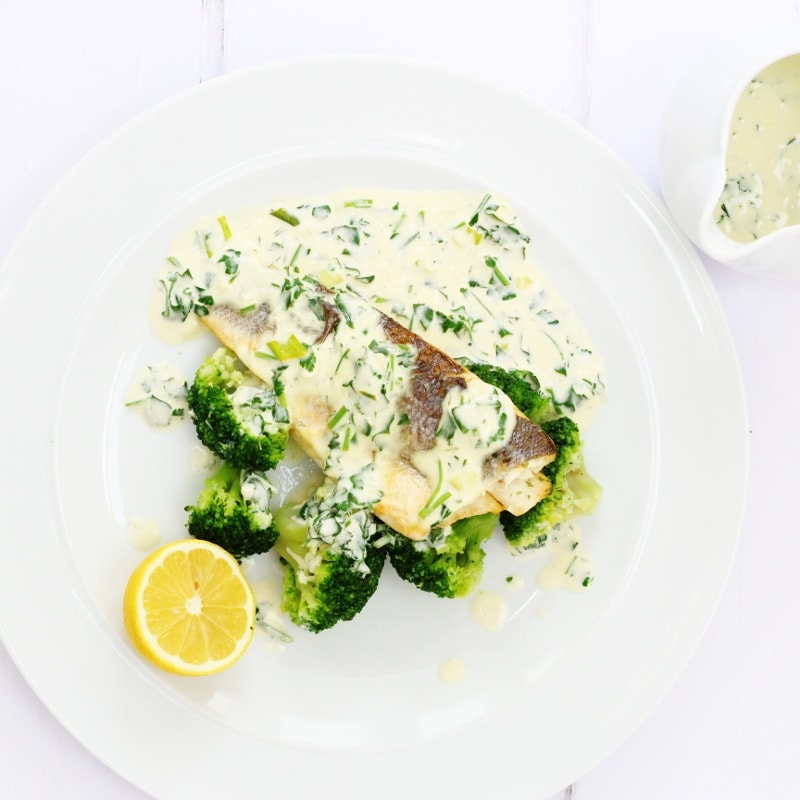 Lemon and parsley sauce with white fish and broccoli