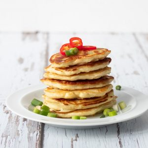 stack of sweetcorn fritters with spring onion and chilli