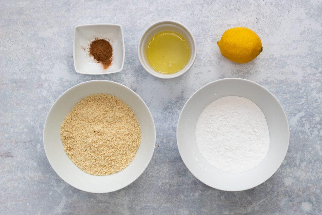 Ingredients for Cinnamon start biscuits: ground almonds, icing sugar, cinnamon, egg white, lemon juice
