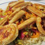Gratd rainbow salad with sesame feta fritters
