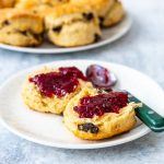 fruit scone on a plate with jam