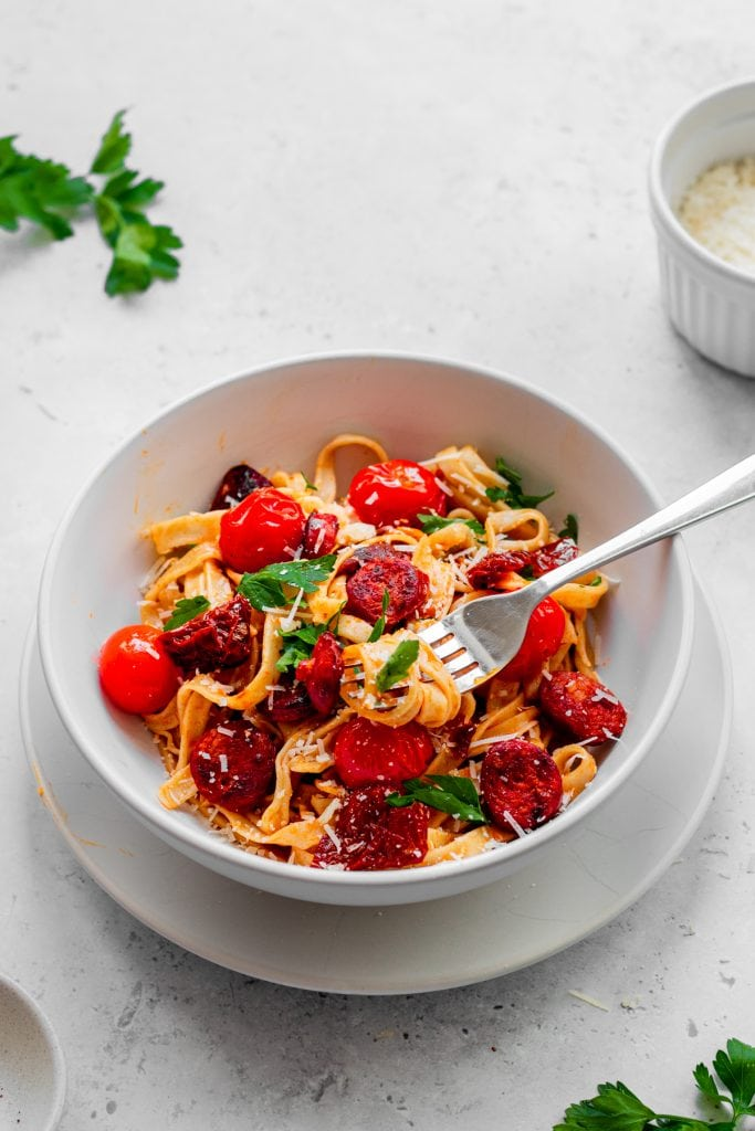 Bowl of pasta with sundried tomatoes and chorizo