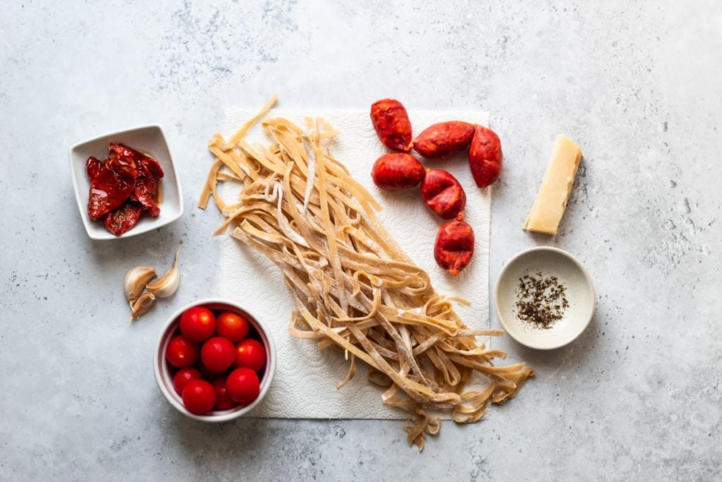 Ingredients for pasta with sundried tomatoes and chorizo