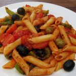 olive and dukkah pasta on a plate