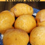 These delicious homemade nigella seed and tomato bread rolls are tasty fusion of Indian and Mediterranean flavours! Perfect for burgers, sandwiches or as a side to go with soup. #breadrolls #tomatorecipes #breadrecipes #breadmakerrecipe