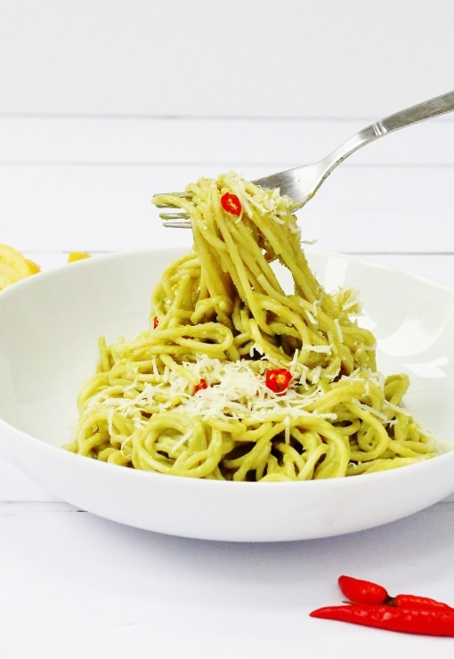 Avocado spaghetti with chilli and lemon juice topped with a little parmesan