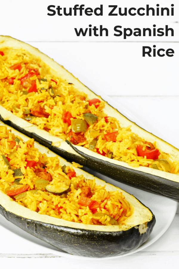 This overgrown zucchini stuffed with Spanish rice is a delicious way to eat seasonal produce. The rice is flavoured with chorizo and paprika and is delicious by itself too. #zucchini #seasonal #homegrownvegetables #stuffedvegetables #rice #comfortfood