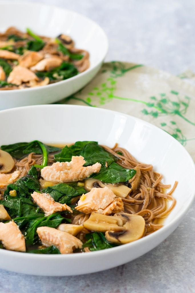 two bowls of salmon miso soup with soba noodles