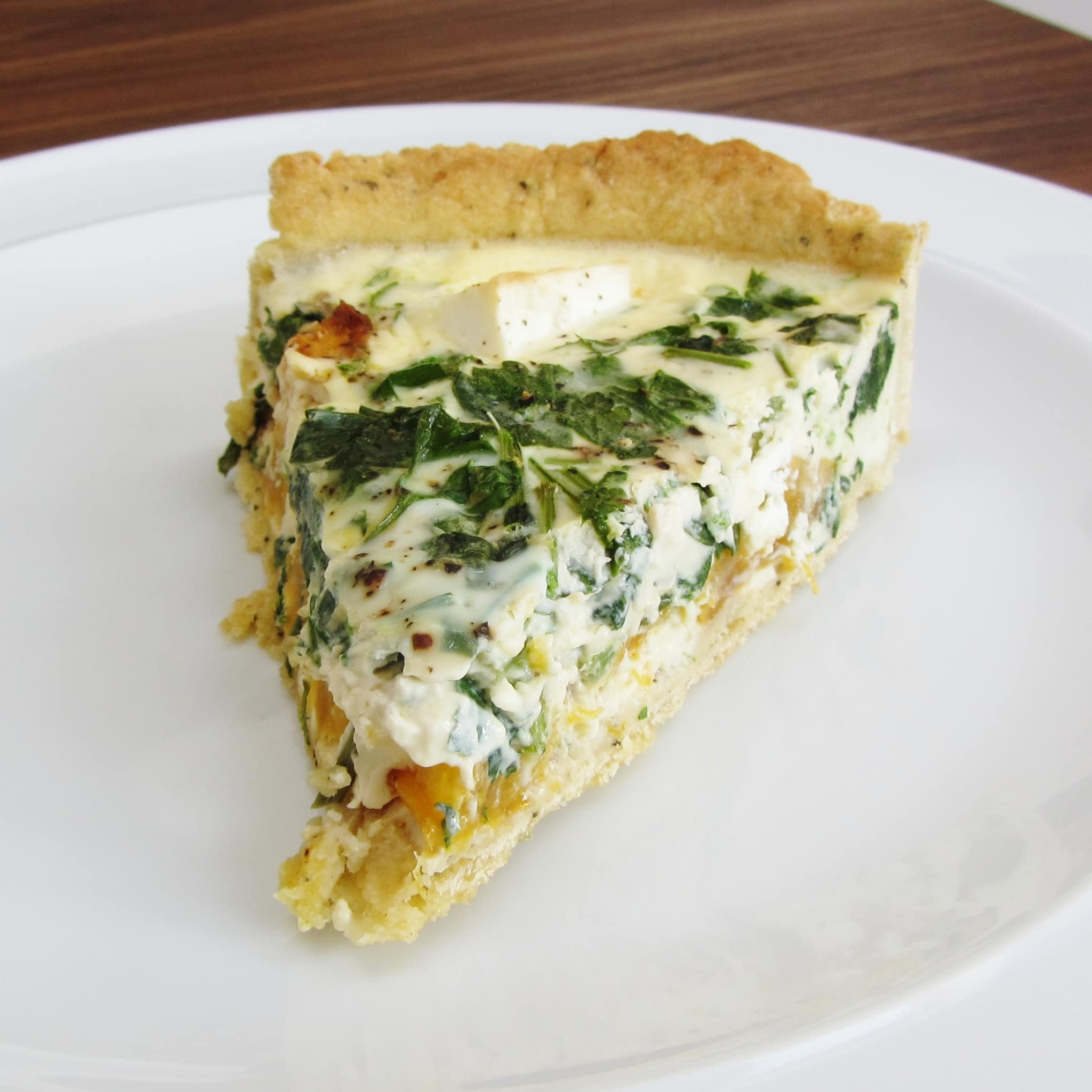 Vegetarian roasted pumpkin, spinach and feta quiche