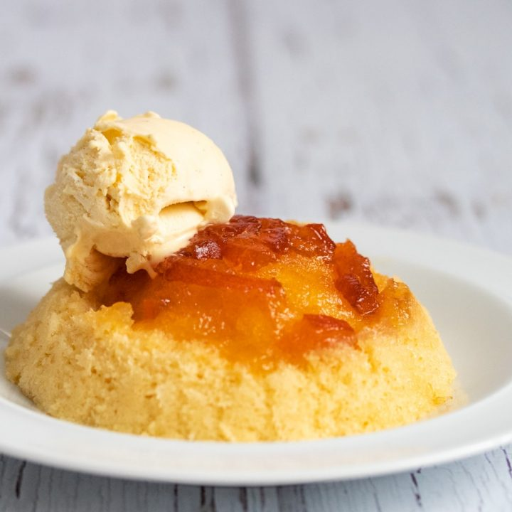 Microwaved marmalade sponge pudding with ice cream