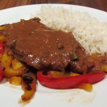 Slow cooked pork in a spicy peanut butter sauce