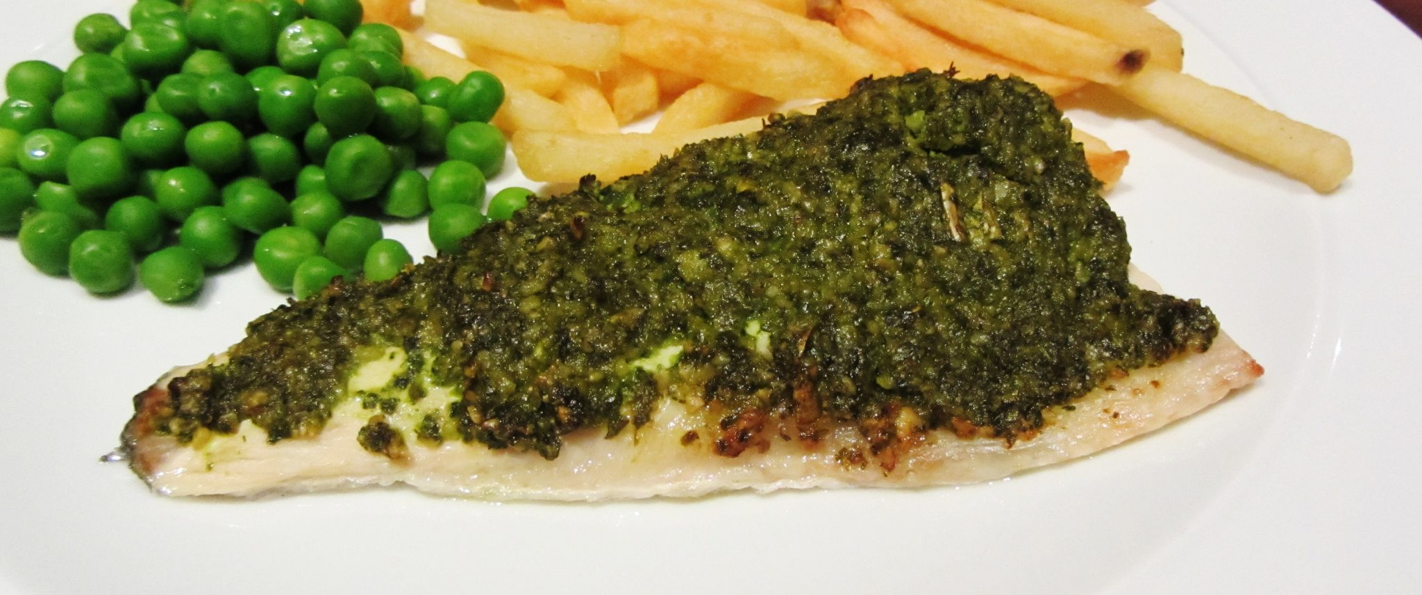 Grilled Sea bass with a pesto coating