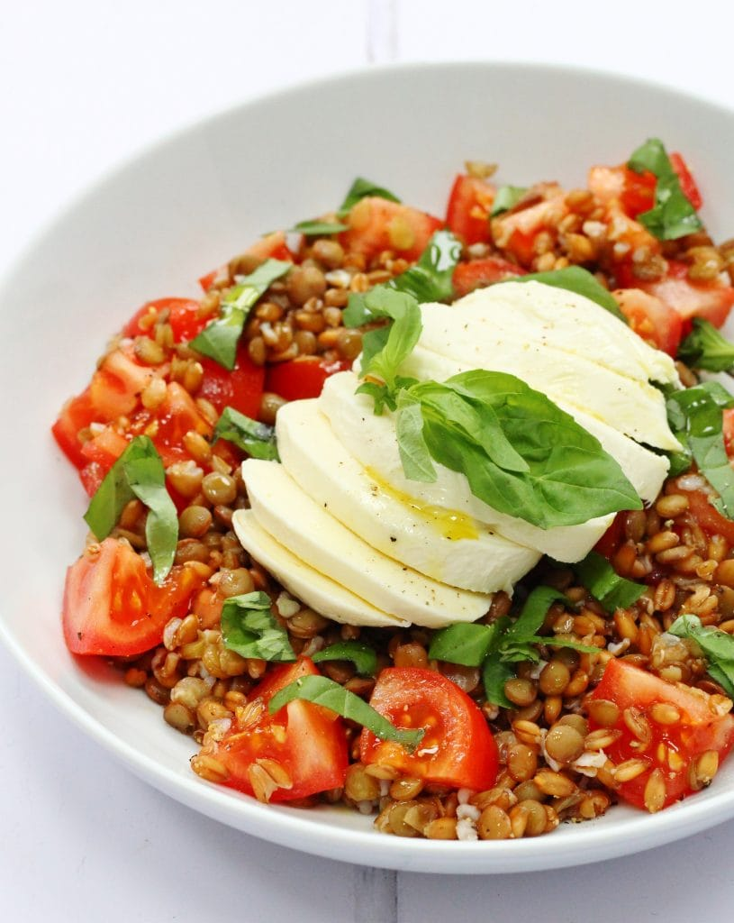 This spelt and lentil caprese salad is a delicious variation on a traditional caprese salad. A base of spelt and lentils plus tomatoes, basil and mozzarella