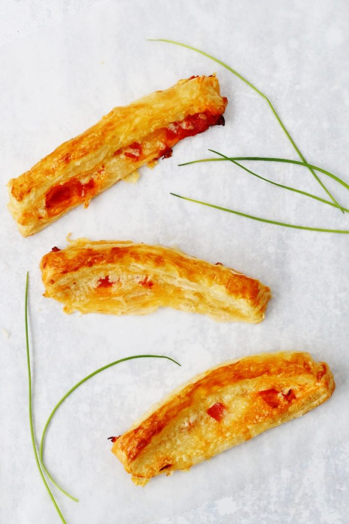 flatlay of 3 chorizo and cheese straws with a few chives