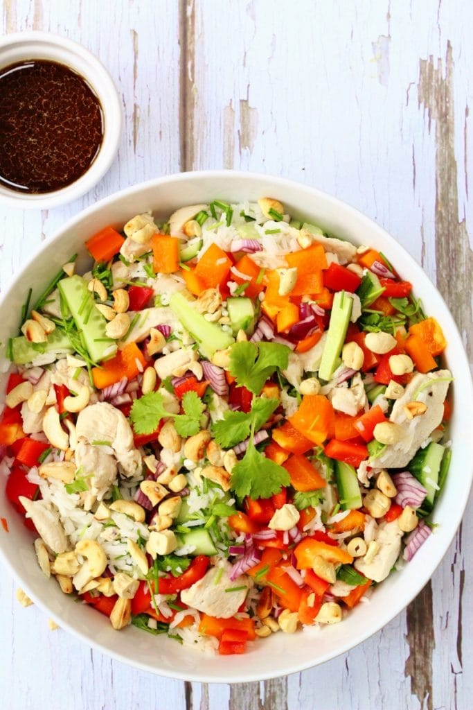 Oriental rice salad with crunchy vegetables and chicken with a soy lime dressing