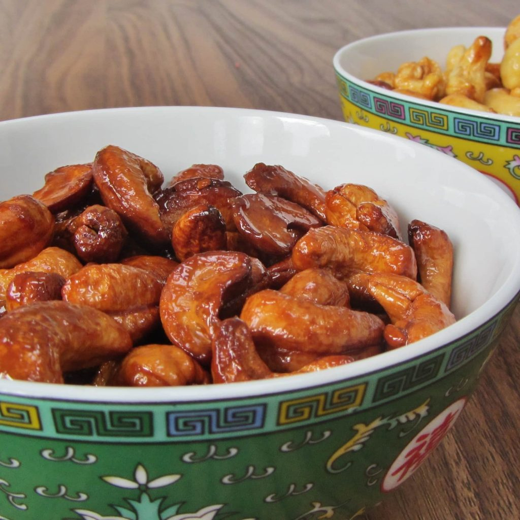 two bowls of honey roasted cashew nuts