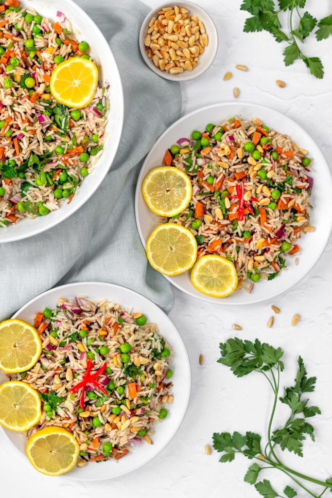 bowls of rice and pea salad with lemon slices