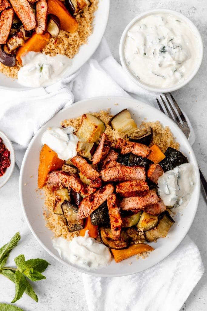 plates of harissa marinated lamb salad
