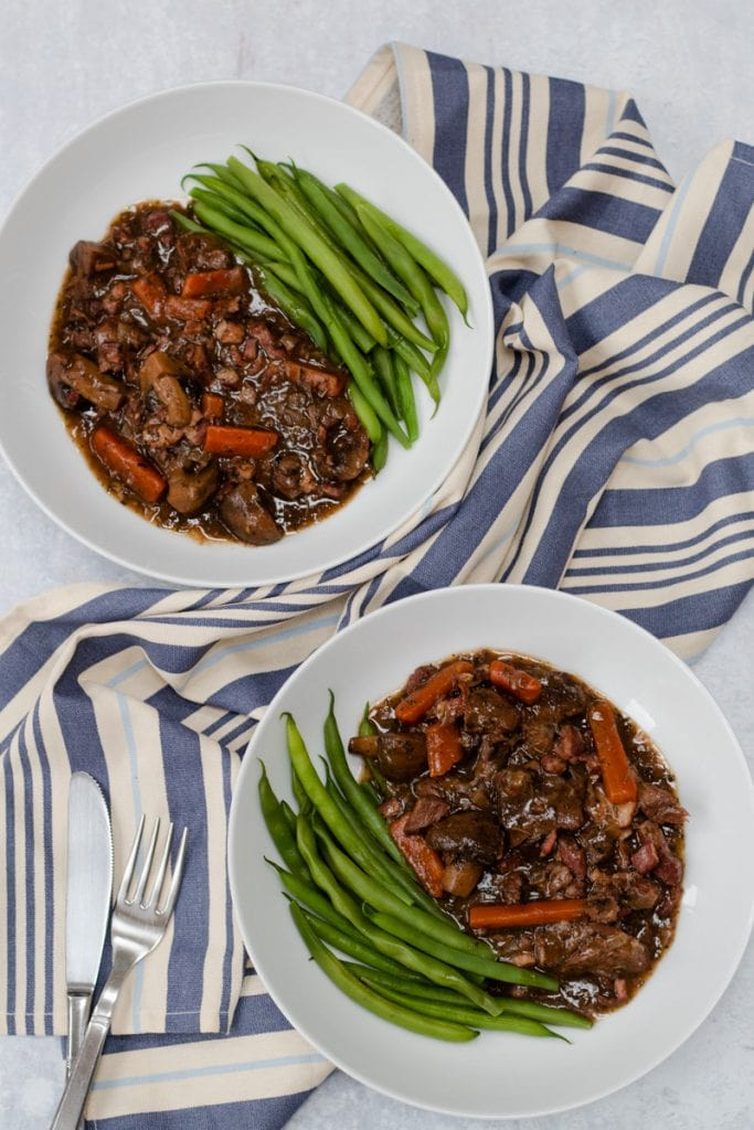 two bowls of slow cooker beef bourguignon