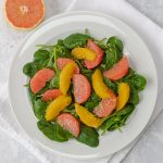plate of spinach and citrus salad